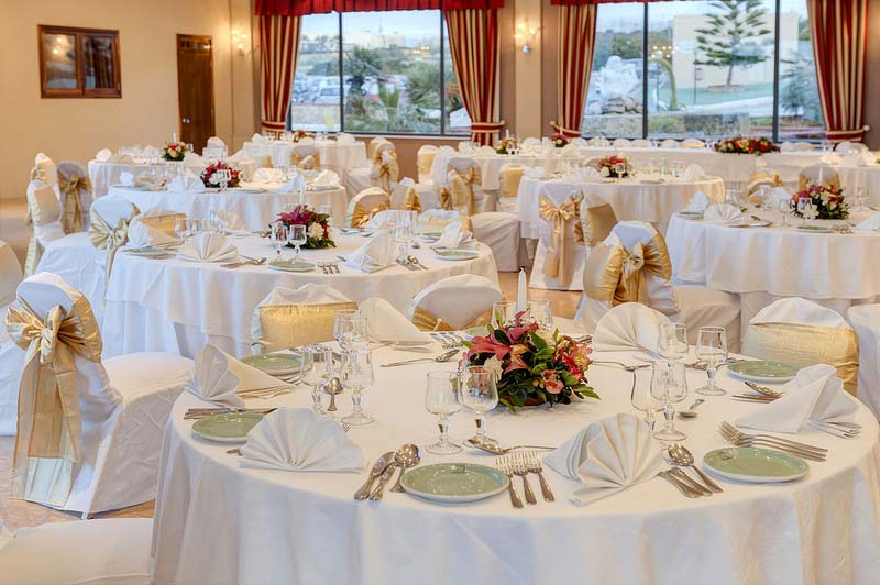 Maltinero beach malta wedding venues sea views gold and white wedding theme table decorations junglespirit Gallery